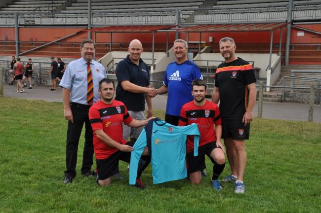 NEW ARRIVALS: Back row (from left) - Steve Smith, Paul Kingston (Summer Land Air Conditioning Ltd), Martin Chandler, Geoff Sluman; front - Jon Harriott, Liam Birch (football club captain)