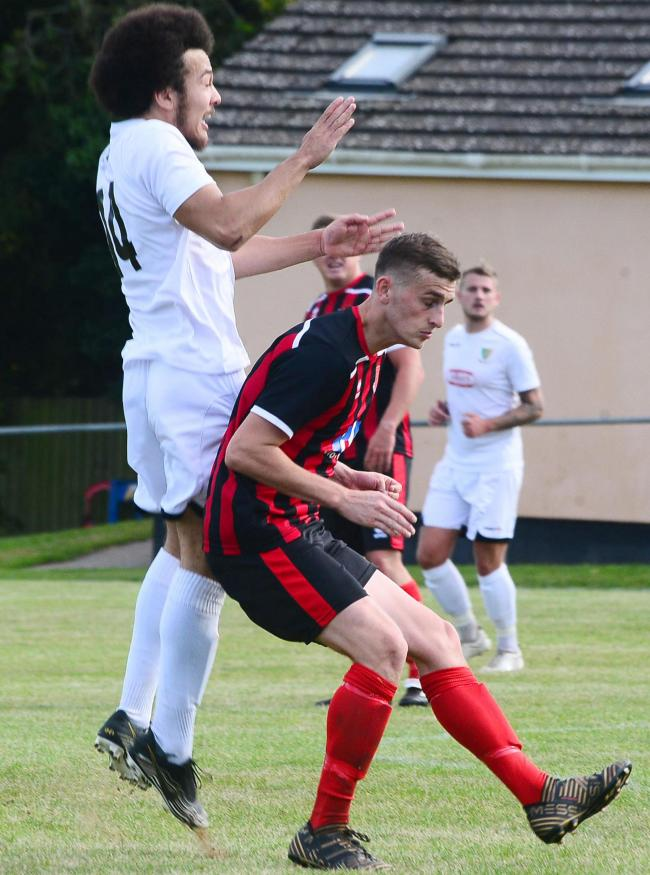 SIGNING: Ryan Brereton (red and black kit) in action for Bishops Lydeard last season