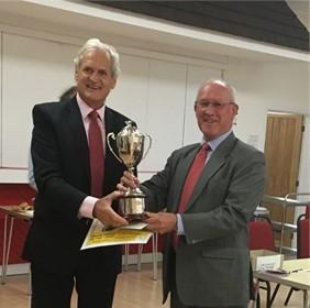 PRESENTATION: Cllr Mike Solomon collects the Somerset Playing Field of the Year on behalf of Wembdon