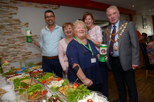 HELPING THOSE IN NEED: Mayor of Bridgwater Cllr Tony Heywood joins CHSW fundraisers at The Green Olive