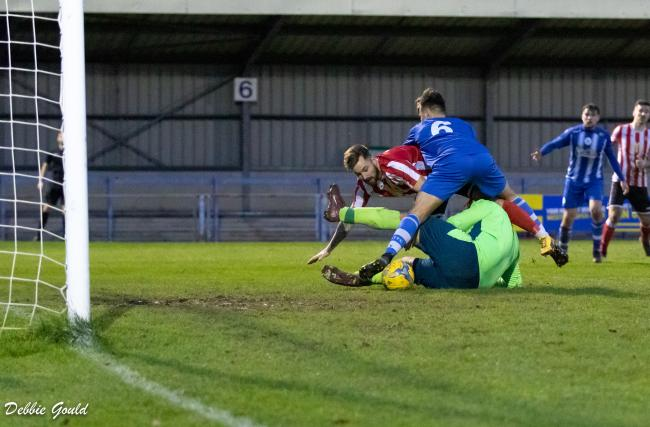 EDGED OUT: Bridgwater Town striker Jack Taylor is beaten to the ball during Saturday's match away to Clevedon Town. Pic: Debbie Gould