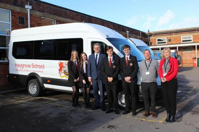 INVESTMENT: Staff and pupils with the new minibus