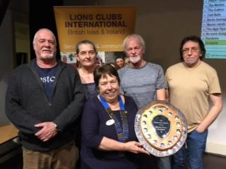 WINNERS: Lion President Brenda Wood presenting the Brains of Avalon trophy to the winning team Forum