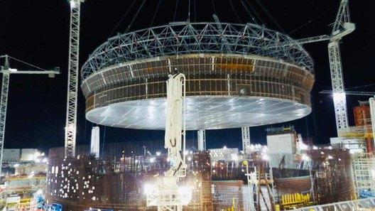 PROGRESS: The enormous liner cup is lifted into place in December