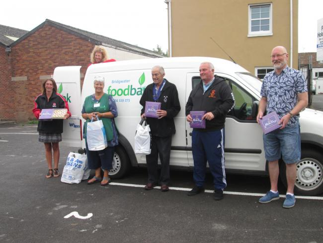 DONATION: Arthur Leigh, President of the Bridgwater Gangs and Features, with Chairman Sean Rendells, Secretary Ness Speed, and Old Folks Show Organiser Wayne Anker, handing over the items to volunteers of the Foodbank