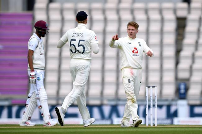 GONE: Dom Bess (right) celebrates taking the wicket of West Indies' Jermaine Blackwood (pic: Mike Hewitt/NMC Pool/PA Wire)