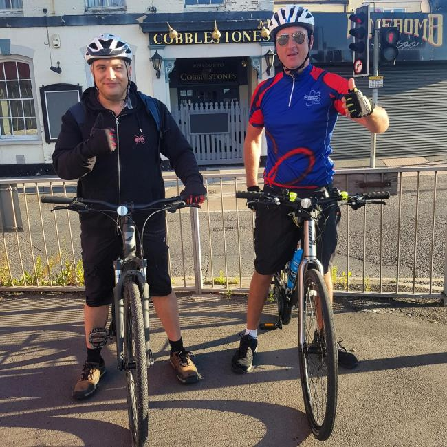 SETTING OFF: Jason Theobold and Antony Harwood gives the thumbs up as they start their challenge