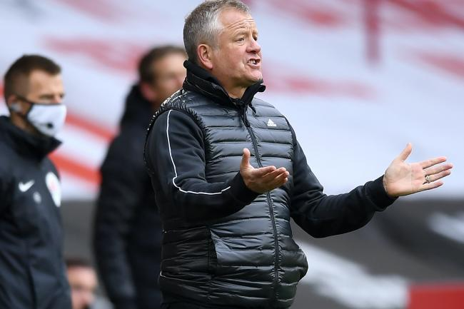 Sheffield United manager Chris Wilder insists his players will stick together after a first point of the season from a 1-1 draw with Fulham.