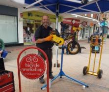 REPAIRS: Staff from The Bicycle Workshop at a health check session in Fore Street