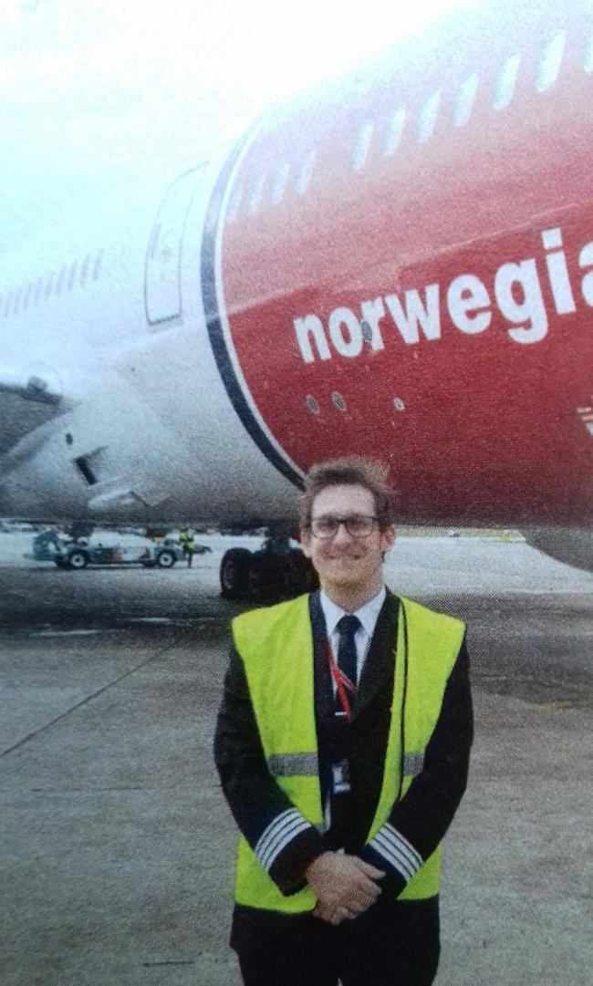 LIFETIME AMBITION: Richard beside a Norwegian Air jet he piloted