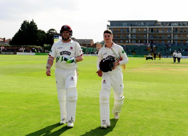 Bridgwater Mercury: VICTORY: Davies, left, with Somerset captain Tom Abell