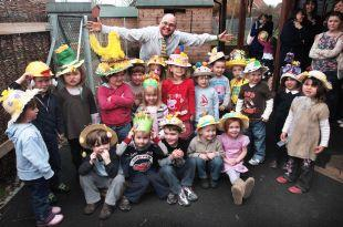 Youngsters at Octopus day care enjoy Easter in their bonnets.