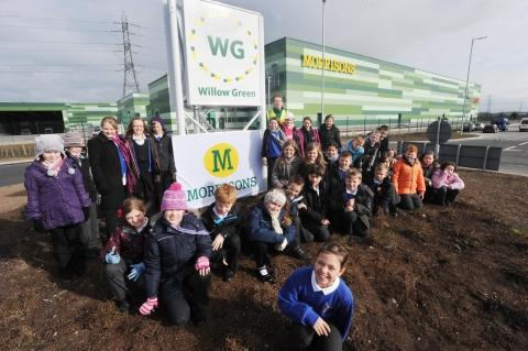Alice Nunn (front) with pupils from Kingsmoor Primary School at the Morrisons distribution centre. Photo: Steve Richardson.