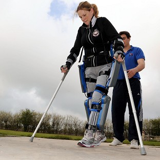 Claire Lomas trains for the London Marathon in a bionic ReWalk suit with physiotherapist Matt White near Hull