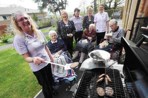 Residents watch on as Wendy Parkin tackles the barbecue