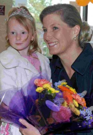 Danielle Phillips, five, presents Sophie with a bunch of flowers. PHOTO: Andy Slocombe