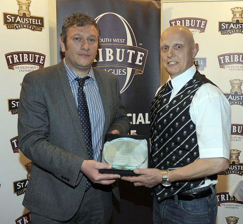 St Austell Brewery's Danny Crabb presents the award to John Evans from North Petherton Rugby Club.