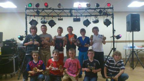 North Petherton Under 11s proudly show off their trophies.