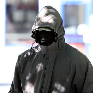 Trevor Gray arrived at Derby Crown Court with his face covered