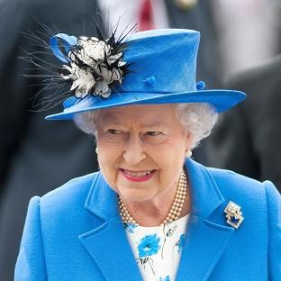 The Queen arrives for the Investec Derby Day of the Investec Derby Festival at Epsom Racecourse