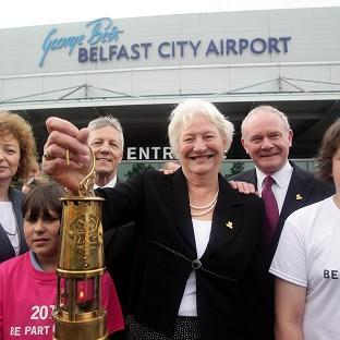 Dame Mary Peters with the Olympic Flame at George Best Belfast City Airport as the Torch Relay reached Northern Ireland