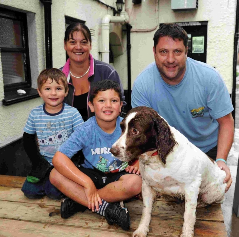 Landlords Sally Taylor and Jim Winkworth with children Seth and Jed, and Bodger the dog