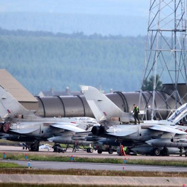 Air ground crew work on Tornado planes at RAF Lossiemouth following an incident in which two RAF Tornados crashed off the coast of Scotland