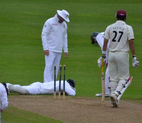 MARK Boucher lies on the ground after being hit. PHOTO: DavesSCCCnews