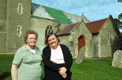 PICTURED at St John the Baptist in Pawlett are churchwarden Pam Kemp, who discovered the theft, and the Rev Doris Goddard. PHOTO: Jeff Searle