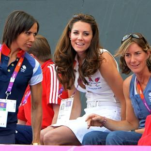 The Duchess of Cambridge watches the British women's hockey team win bronze with Kelly Holmes, left, and Katherine Grainger