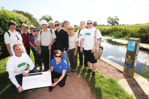 Russell Parsons (centre with cane) with representatives from Specsavers who joined him on his walk along the River Parrett Trail and raised £500 for Somerset Sight.