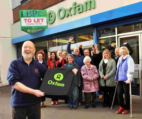 Michael Eavis with Oxfam staff and volunteers