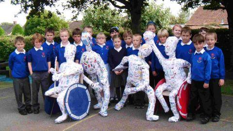 Pupils with their sculptures