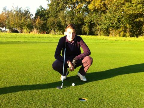 Jack Dray on the final hole of his golf challenge