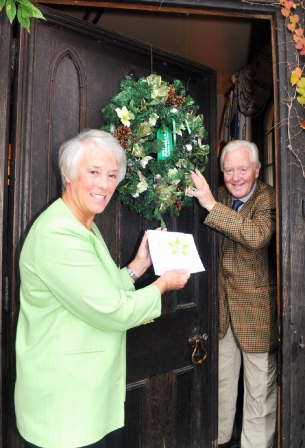 Macmillan Christmas Fair organiser Sue Bridger and Sir Benjamin Slade