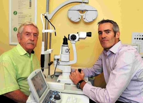 Michael Johnson with optometrist Steve Rosser