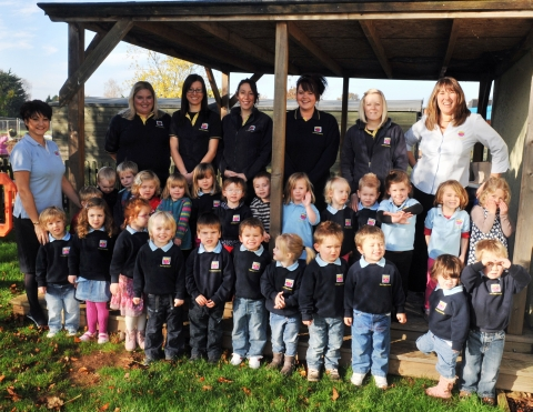 Staff and children celebrate ten years of First Class Nurseries. Photo: Jeff Searle