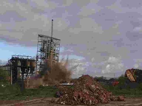 The former sulphuric acid plant comes crashing down.