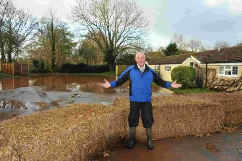 Pub landlord Mike Andison asked a farmer to place hay stacks in front of the pub - but it didn't stop the floodwater.