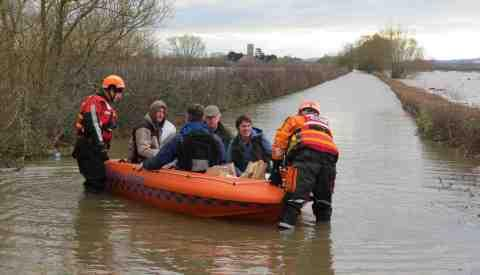Villagers being helped by rescue services in Muchelney