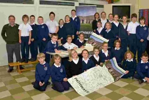 Pupils from Catcott Primary School signing the community banner supporting a project to redevelop the Somerset Rural Life Museum.