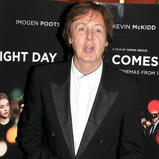 Sir Paul McCartney will perform with Nirvana band members Dave Grohl and Krist Novoselic