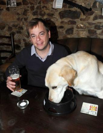 Gavin Ridley and his pet dog, Milo, at the Poppe Inn in Tatworth. Do not fear - this photo was set up just to illustrate the story. Dogs are NOT actually allowed to sit at the table for their dinner!