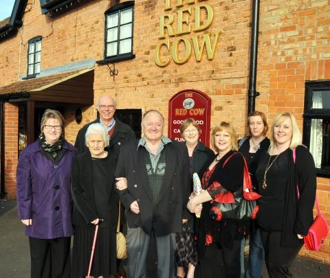 Dorris and Dennis Watts with family and friends outside the Red Cow pub in Brent Knoll. Photo: Jeff Searle.