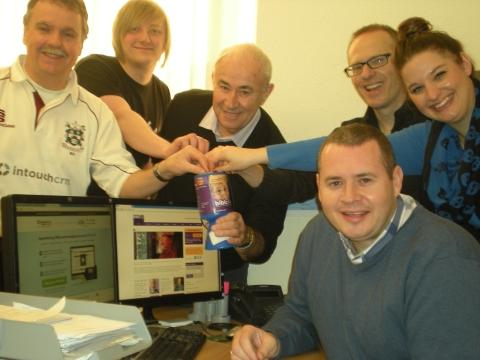 James White, CEO of IntouchCRM (right), and staff pledge to support children's charity, Bibic. Photo: submitted.