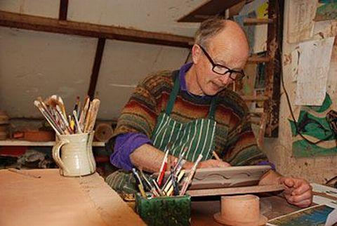PHILIP Leach working in his studio as his grandfather did.