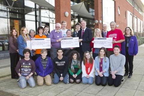 Representatives of the three chosen charities being presented their cheques by College Principal Mike Robbins with Student Support staff and Students' Union representatives, including President Georgia Hodges (pictured next to Principal). Photo: submitt