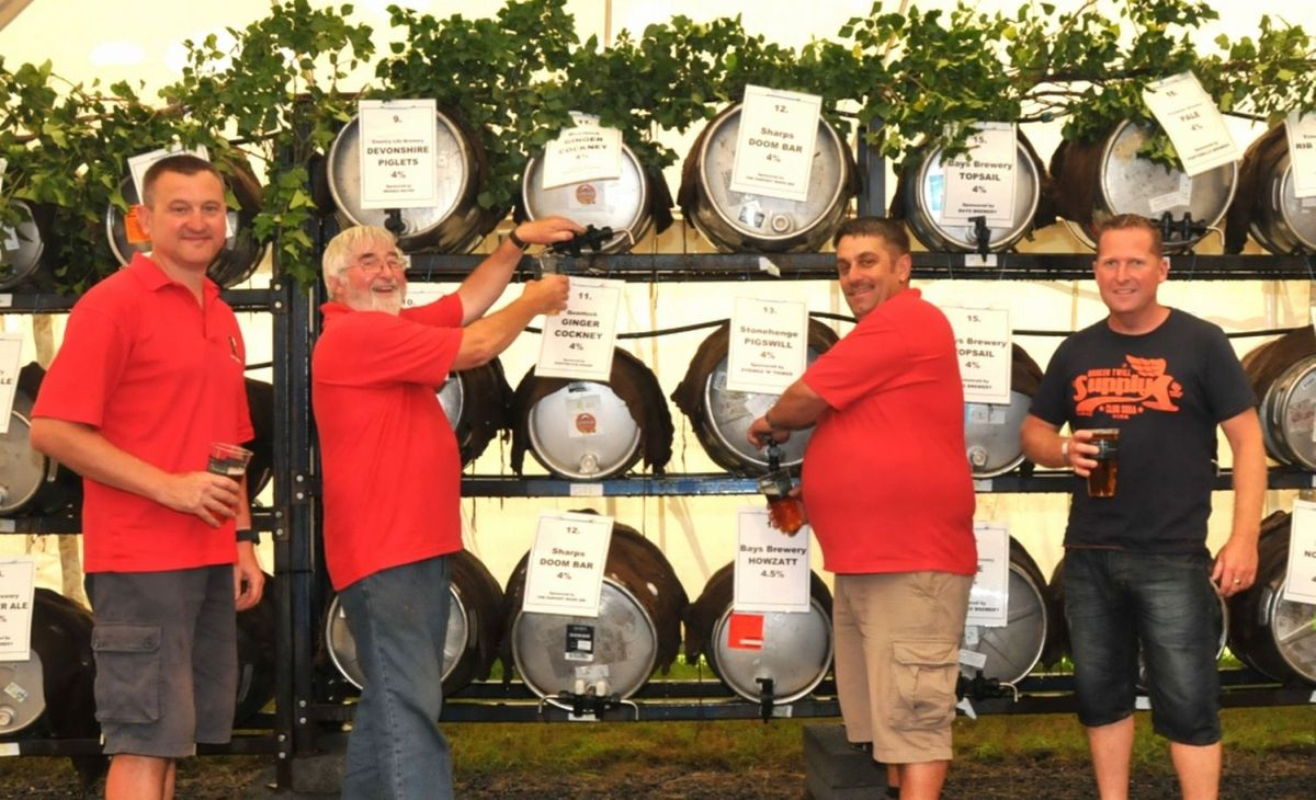 NEWT organiser Frank Clegg with fellow Newt organisers before 102 casks of ale.