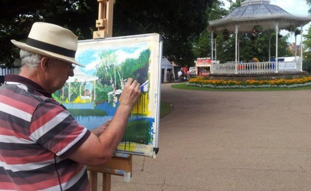 Bridgwater Mercury: ARTIST-IN-RESIDENCE Norman Steel painting at Taunton Flower Show in 2013. PHOTO: Taunton Flower Show.