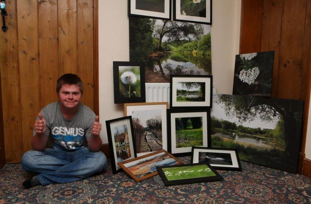 UNLIMITED CHOICE: The award-winning shot of Oliver Hellowell with his photos.